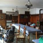 Saloni a piano terra comunicanti anche con la cucina.